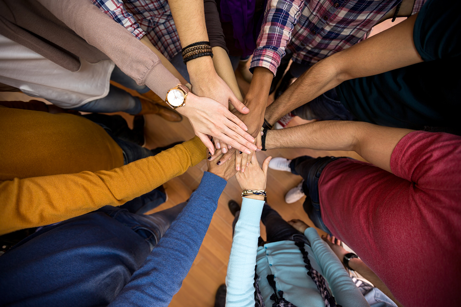 hands in a stack indicating teamwork