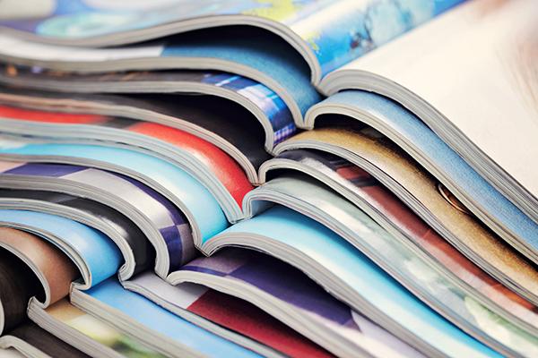 Pile of open journals